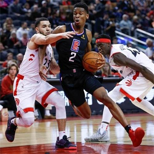 Los Angeles Clippers guard Shai Gilgeous-Alexander, a Hamilton native, drives between the Toronto Raptors' Fred VanVleet and Pascal Siakam during his first NBA game in Canada on Feb. 3. Gilgeous-Alexander visited his former high school, St. Thomas More, on Tuesday. - Rick Madonik,Toronto Star File Photo